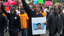 Protestors march in Ferguson, Missouri following the police shooting of Michael Brown.