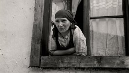 Jewish woman leaning out window.