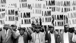"Photo of a large group of Memphis sanitation workers holding signs that say ""I Am A Man"" during the 1968 Memphis strike."