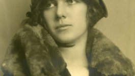 Portrait of young Martha Waitstill wearing a hat and a fur.