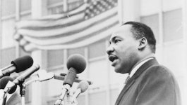 Image of Dr. Martin Luther King, Jr. speaking into a microphone