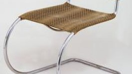 A chair made with a single tube of steel and two pieces of fabric for the seat and back rest.