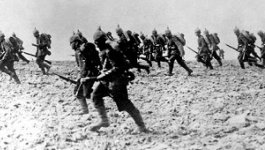 photo of WWII soldiers walking on beach
