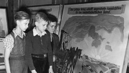 young students looking at a poster