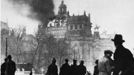 A crowd of Germans look on as the Reichstag building burns on February 27, 1933.