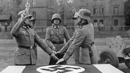 Nazi soldier taking oath with two other soldiers in photo.