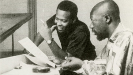 "David Porter and Isaac Hayes work together on the song ""Soul Man"" at a piano."