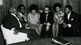 The Staple Singers sit with the owners of Stax Records, William Bell and Jim Stewart, in Memphis, TN.