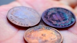A close up of Queen Victoria, King Edward, and East India company coins.