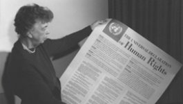 Photo of Eleanor Roosevelt holding up the Universal Declaration of Human Rights