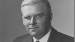 A black and white portrait of a middle-aged man.