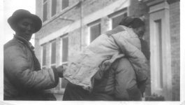 A woman is being carried to the hospital.
