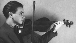 young man in profile playing violin