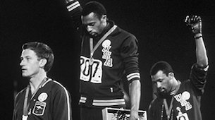 Dr. Tommie Smith at the 1968 Olympic medal ceremony.