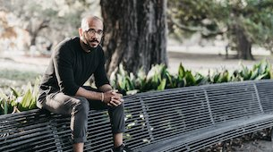 Dr. Clint Smith sitting on a park bench