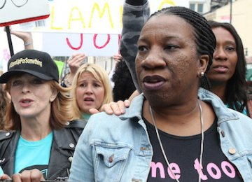 Tarana Burke and a crowd of women in a #MeToo protest.