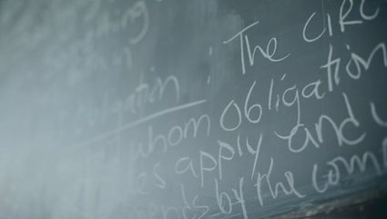 Universe of Obligation definition on a classroom chalkboard.