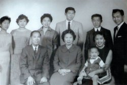 Formal family portrait of the Wong family.