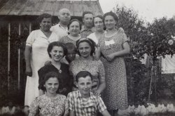 Family portrait with children, parents, and grandparents. Taken circa 1930-1940.
