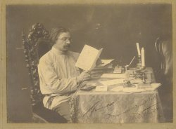 Seated portrait of Sholem Aleichem at his writing desk in Saint Petersburg, circa 1904.