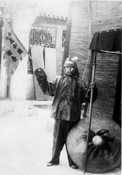 A Boxer soldier waving a flag, 1900.