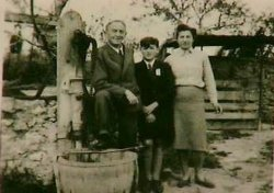 Young Peter Feigl standing outside with his parents Ernst and Agnes.