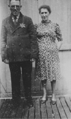 Black and white photograph of Noah Eliezer and Mindel Finker wearing yellow Stars of David.