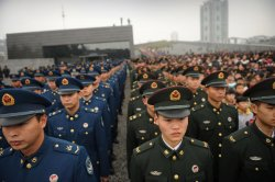 Photo of Chinese military members standing in lines of formation.