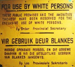 """Sign in English and Afrikaans: """"For Use by White Persons/ These public premises and the amenities thereof have been reserved for the exclusive use of white persons/ by Order Provincial Secretary"""""""