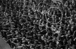 Photograph of August Landmesser in 1936, a shipyard worker in Hamburg, Germany, refusing to participate in the Heil Hitler salute.