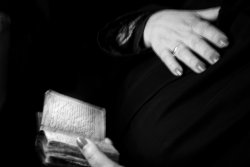 A woman's hands as she holds a Bible.