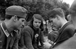 Hans Scholl, Sophie School, and Christoph Probst conversing outdoors in 1942..