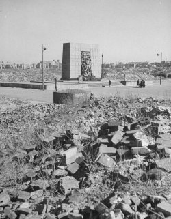 Stone monument surrounded by rubble in Warsaw, circa 1948.