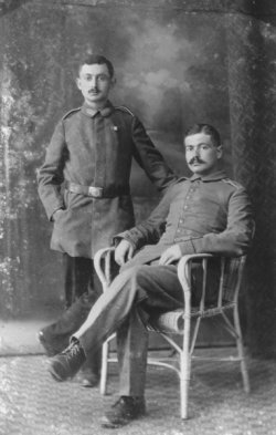 Formal portrait of two men posed in military uniforms.