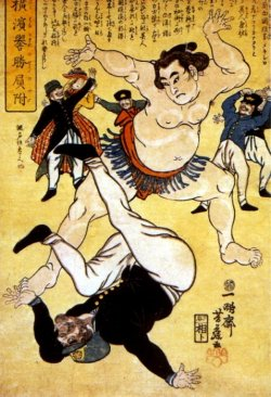 A sumo wrestler has knocked a Western opponent onto the floor. Japanese writing surrounds the image.