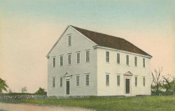 An illustration of a plain, rectangular, white building.