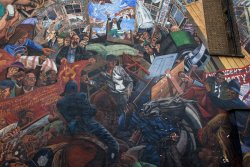 Mural in London depicting scenes from Battle of Cable Street.