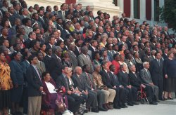 A large group of white and black South African politicians posing for a formal picture.