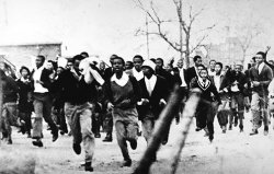 Group of black South African schoolboys running frantically