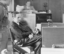 Photograph of Otto Ohlendorf testifying on his own behalf at the Einsatzgruppen Trial, 1947.