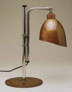 A plain desk lamp made with steel tubes and a brown lampshade and base.