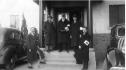 Group photo on the steps of the Nanjing Safety Zone headquarters, circa 1937.