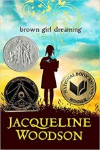 Cover art for Brown Girl Dreaming book by Jacqueline Woodson. Silhouette of a  young girl reading a book with a sunny sky behind her.